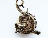Spinning steampunk dragonfish brooch