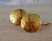 Gold  leaves and snow flakes dangle  earrings