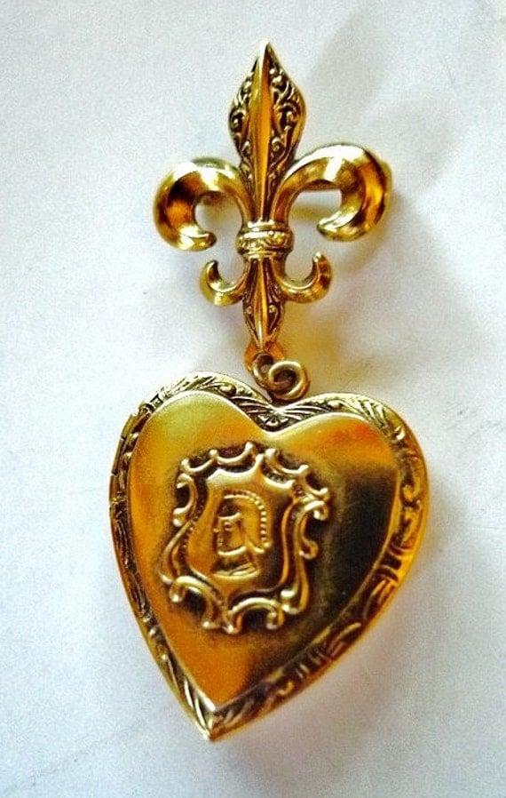 gold heart locket with fleur de lis pin   locket  1950s