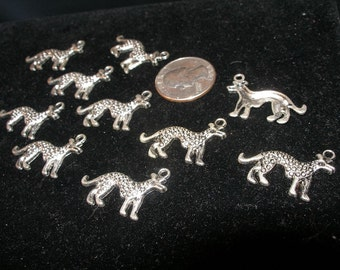 Anubis, the dog god, or non-howling wolf, or maybe a hyena  14 silver charms    --  paganteam,  Team ESST, OlympiaEtsy