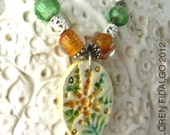 Ceramic Flower Pendant Necklace In Ambrosia Tan And Leaf Green Glazes Along  With Glass And Metal Beads