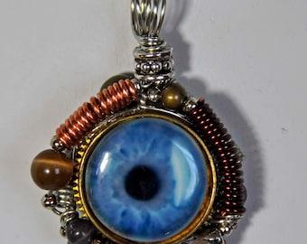 Blue human eyeball eye art porcelain pendant wirewrapped  with coils unisex steampunk goth