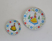 Vintage Alpine Maids toy plate and saucer from tin lithographed tea set by Ohio Art