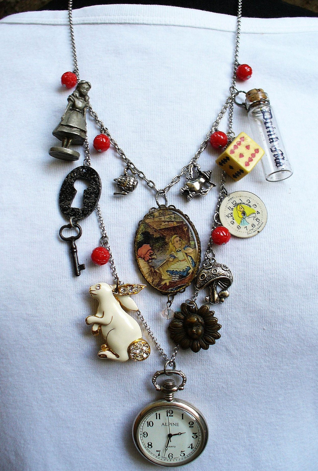vintage alice in wonderland bib charm assemblage pocket watch