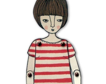miniature moveable paper doll (in red stripes)