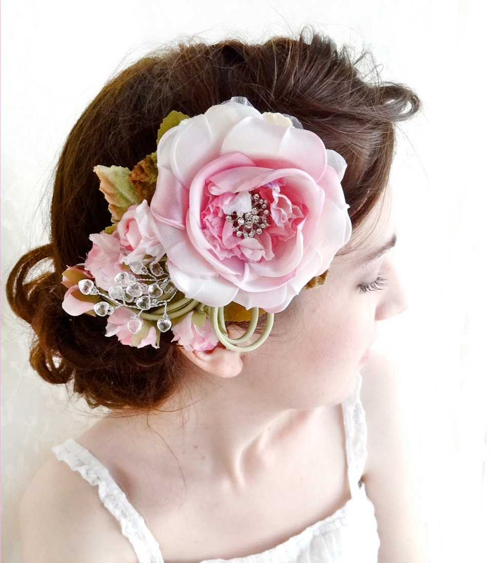 Pink flower hair pins. Wishing to add some volume to your hairstyle, use these hair pins. Because such lush pink flowers can be the indispensable elements to create your romantic look.