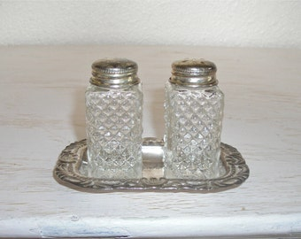 vintage pressed glass salt and pepper shakers on ornate silver tray - shabby cottage chic - hollywood regency