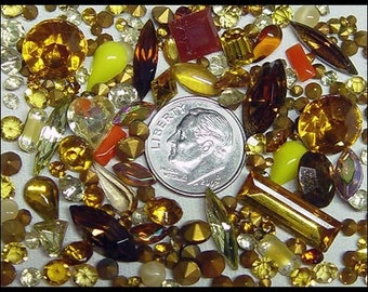 More than 100 Topaz and Amber Rhinestones Variety of Shapes Sizes Colors