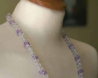 Crocheted beaded thread necklace with transparent white and transparent Amethyst plastic beads