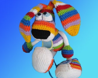 Crochet toy Amigurumi pattern - Rainbow Rabbit with a tie and sneakers.