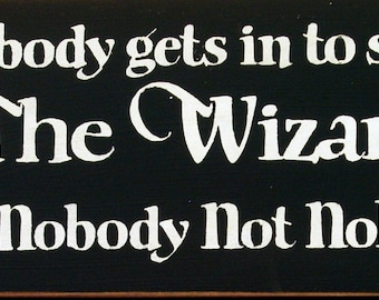 Nobody gets in to see the Wizard not nobody not nohow primitive wood sign