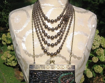 Embellised vintage 1960s brown pearl necklace and glam sequin peacock clutch set