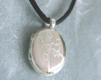 Sale Sterling Silver Locket Hearts on Black silk cord