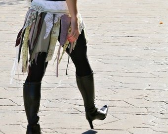 upcycled clothing . XS - M .  tattered wrap skirt . the cats meow