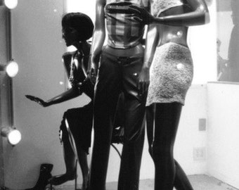Three pink mannequins. Matted fine art photograph.