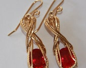 Wirewrapped red faceted stone earrings