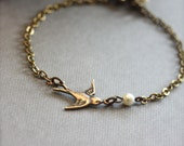 A Tiny Oxidized Brass Flying Swallow Bird with Swarovski Ivory Pearl Bracelet. For Her. Gifts for Bridesmaids Bracelets. Maid of Honor.
