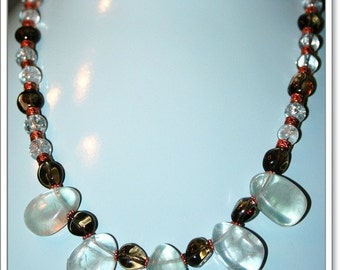 Hand made necklace with Smokey quartz and aquamarin beads spaced with copper round