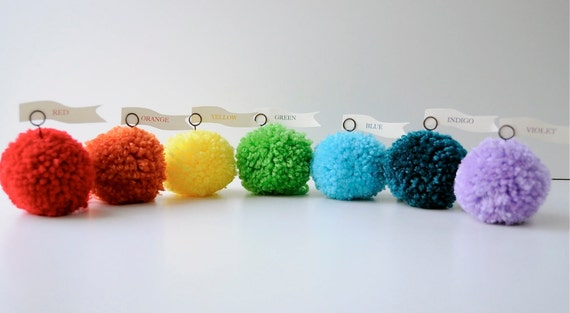 Colors of the rainbow yarn pom pom place card holders, place settings.  Wedding decor, bridal decor