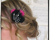 Coquette feather clip in black, pink, and white