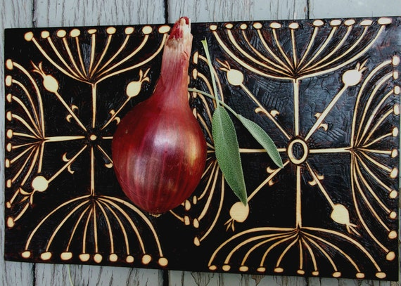 2 sided cutting/serving board, wood burning ooak abstracted seedpod design, brown and white negative space