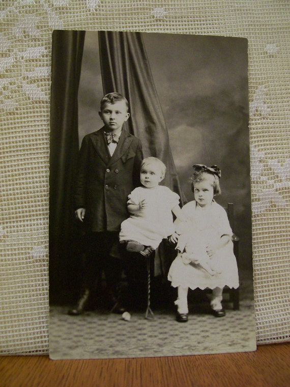 Girl with Doll - Cute Brothers and Sister - Vintage Real Photo Postcard - 1920's