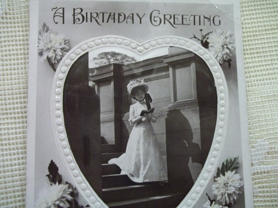 Beautiful Lady in Long White Dress and Hat reading Book - Embossed Real Photo Postcard - early 1900's
