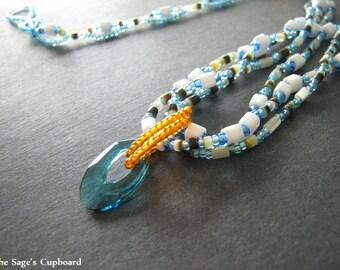 Alexandria Necklace. Handmade Blue, Orange, and Shell Multistrand Pendant Combo