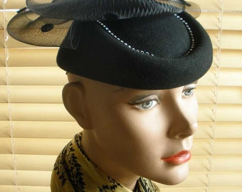 black felt hat with rhinestones and whirlygig polka dot netting