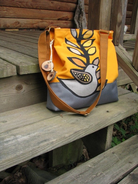 Summer Excitement shoulder bag in tangerine and gray of water repellent canvas with six large pockets and adjustable strap