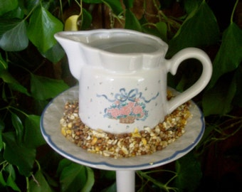 Creamer birdfeeder poke creates a charming addition to your flower garden