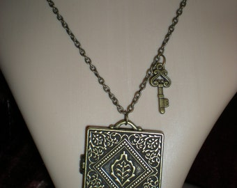 Ornate locket and key with magnetic closure