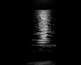 Moon set in the Ocean. Black and White. Fine Art Photoraphy.
