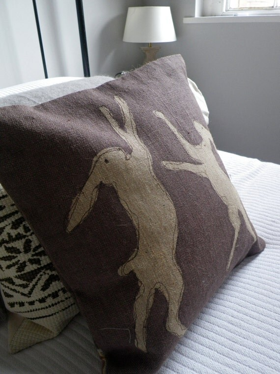 hand printed heather brown boxing hares cushion cover