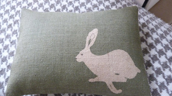 hand printed and stitched little  olive logo hare  cushion
