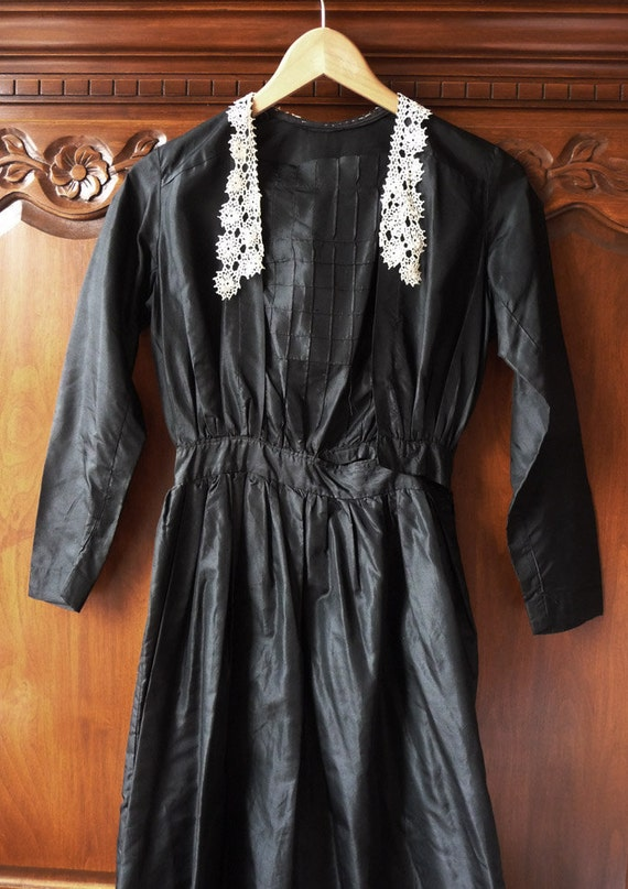 a gorgeous black silk edwardian dress with lace