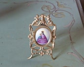Antique Crowned Madonna and Child Hand Painted Miniature Portrait on Porcelain Angel Topped Ormolu Frame