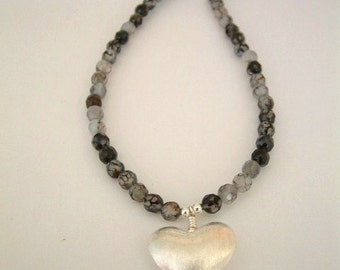 Sterling silver puffed heart and black agate necklace