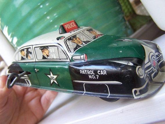 Reserved for Mark Hellman 1950 Lupor Tin wind up Police Car USA