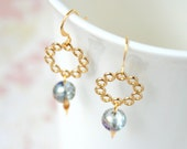 Cosmic ring gold earrings with polished lacy rings and chameleon faceted transparent glass, very airy and shimmering design