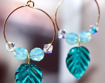 Earring, aqua, Indian glass leaves inside hand-molded gold hoops
