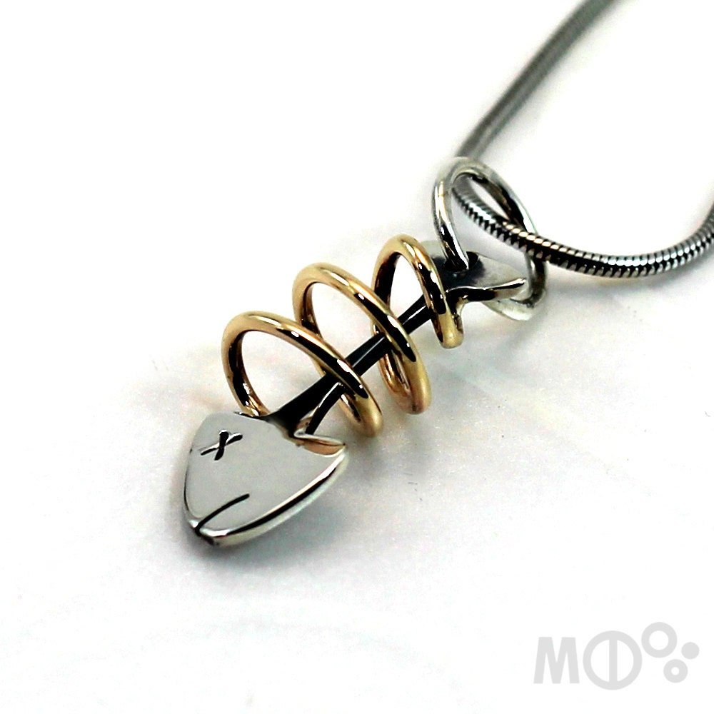 Small fish pendant 10 k yellow gold and sterling silver for Fish skeleton necklace