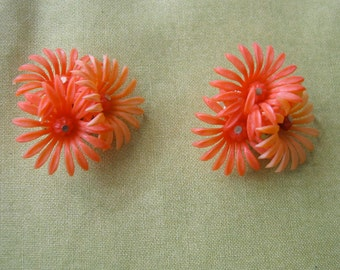 Vintage 1960's, Soft Plastic Flower Clip on Earrings. Orange. Made in Hong Kong.