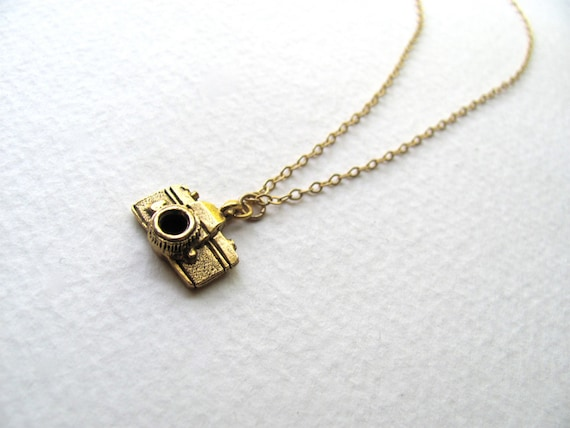 Gold camera charm necklace on delicate 14k gold plate chain, satin finish