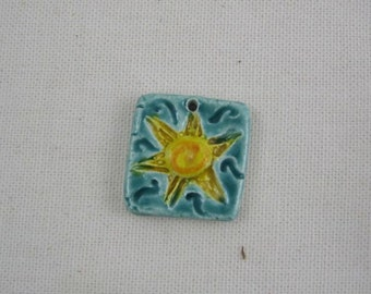 Bright spiral shining sun sculptural ceramic pendant by JDaviesReazor