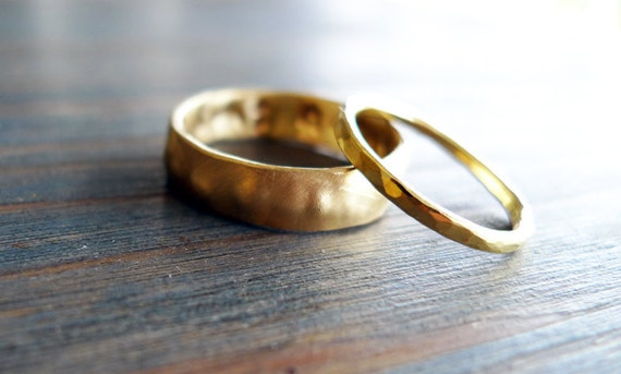 Salka Valka // His and Hers. Set of 2: The Man - 14K Gold Wedding Band. The Woman - Hammered 18K Wedding Band. Hand Made. Recycled Gold.