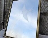 decorative tabletop mirror with bird