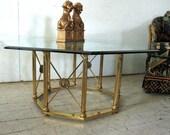"SOLD   Hollywood Regency Brass Glass ""X"" design Octagonal Coffee Table - Maison Jansen Baker"