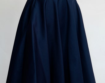 1950s inspired nautical circle skirt in red, navy, black or white. Anchor button detail.