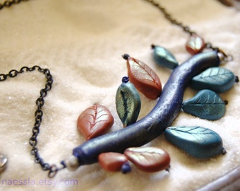 SALE - Horizontal branch with leaves necklace - terracotta teal and indigo